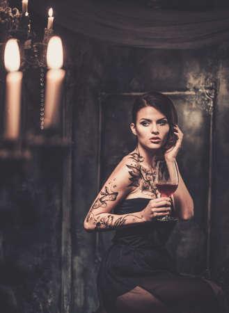 spooky: Tattooed beautiful woman in old spooky interior