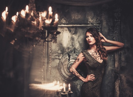 haunted house: Tattooed beautiful woman in old spooky interior