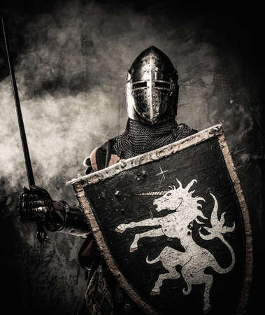 Medieval knight against stone wall photo
