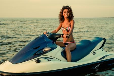 African-american girl sitting on a jet ski photo
