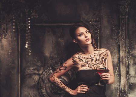 fashionable woman: Tattooed beautiful woman in old spooky interior