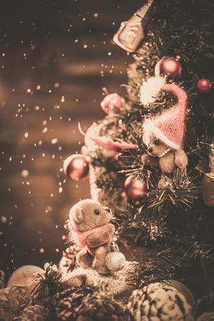 Christmas still life with teddy bears decorating tree  photo