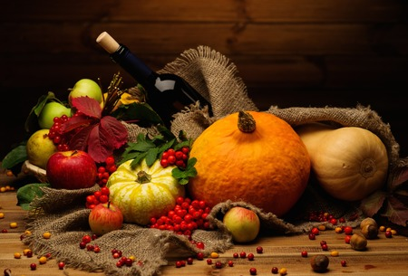 Thanksgiving day autumnal still life with bottle of wine  photo