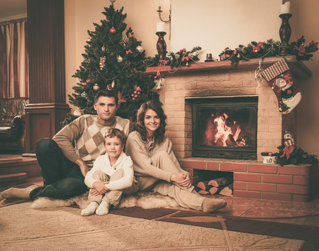 men socks: Family near fireplace in Christmas decorated house interior