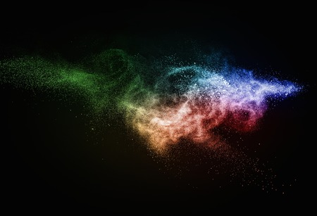 particles: Colourful powder exploding isolated on black
