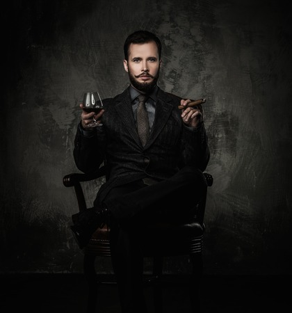 riches adult: Handsome well-dressed with glass of beverage and cigar Stock Photo