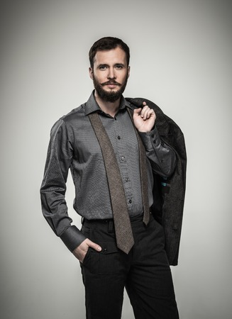 menswear: Handsome man with beard and jacket