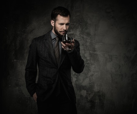 welldressed: Handsome well-dressed with glass of beverage  Stock Photo