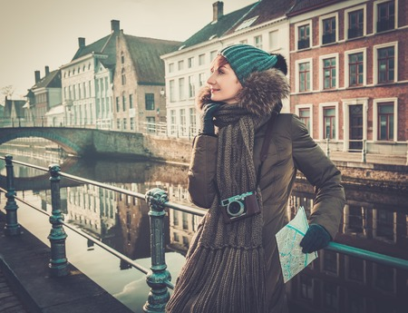 Woman tourist along canal in Bruges, Belgium photo
