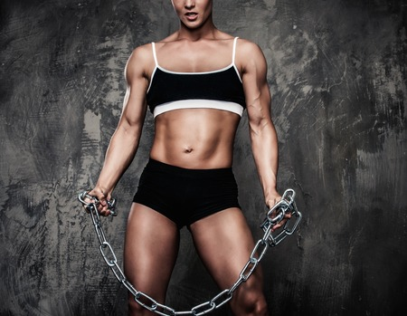 shemale: Muscular bodybuilder woman holding chains