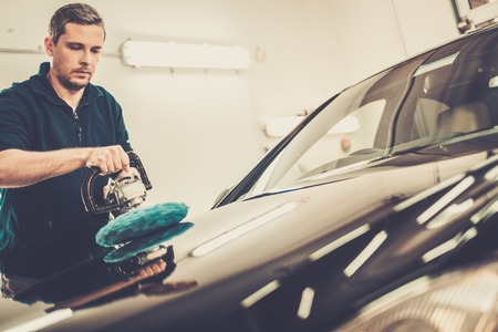 car body: Man on a car wash polishing car with a polish machine