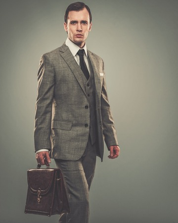 Well-dressed young businessman with a briefcase photo