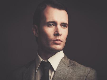 Handsome man in grey suit