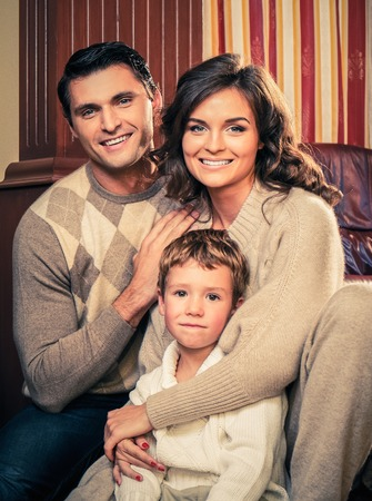 warm home: Family in warm cashmere clothes in home interior