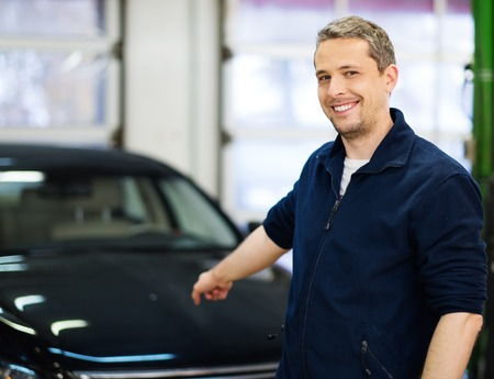 Cheerful man on a car wash photo