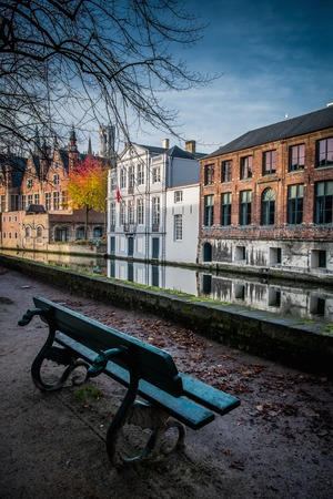 brugge: Bench near canal in Bruges, Belgium