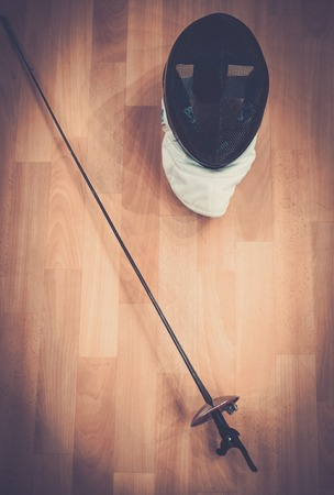 epee: Fencing mask and epee on a floor