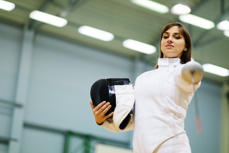 fencing sword: Young woman fencer with epee Stock Photo