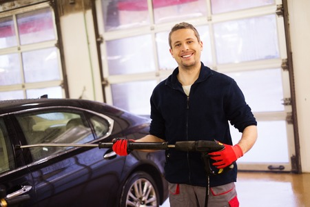 happy worker: Happy worker on a car wash Stock Photo