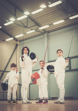 fencers: Children fencers and their  trainer