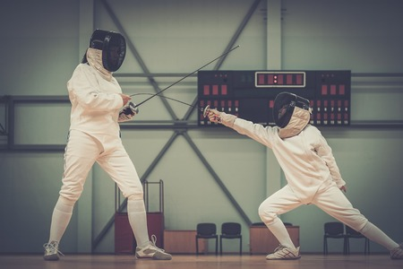 fencing sword: Little girl fencer and her trainer