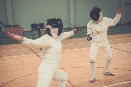 Two women fencers on a training photo