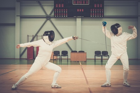 rapier: Two women fencers on a training