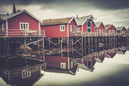 fishing huts: Traditional wooden houses on a water in norwegian village