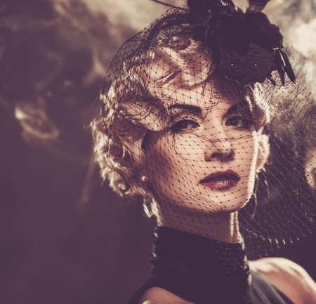 hairdo: Elegant blond retro woman in veil with beautiful hairdo