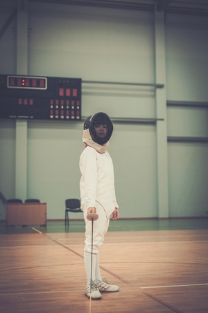 epee: Little girl fencer with epee and mask