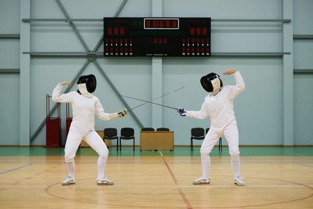 fencers: Two women fencers on a training