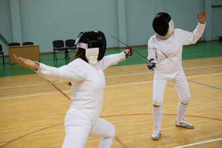 fencing sword: Two women fencers on a training