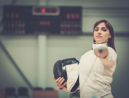 Young woman fencer with epee photo