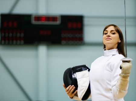 epee: Young woman fencer with epee Stock Photo