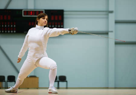 rapier: Young woman fencer with epee Stock Photo