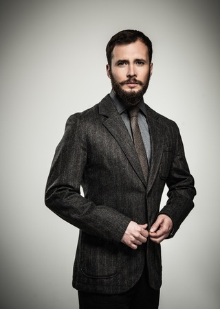 menswear: Handsome man with beard wearing jacket Stock Photo