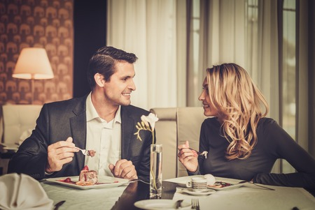 eating pastry: Couple eating dessert in a restaurant Stock Photo
