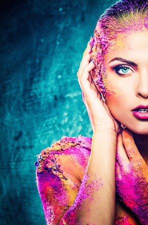 ageing: Beautiful young woman with conceptual colourful body art