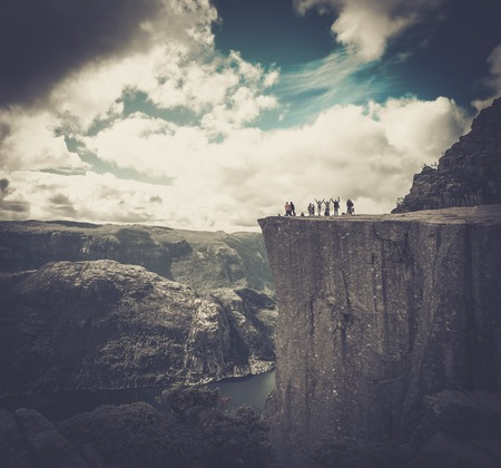 cliff edges: People at Preikestolen, Norway Stock Photo