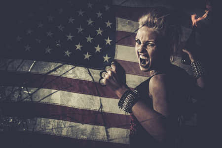 molotov: Punk girl against USA flag with brass knuckles and Molotov cocktail Stock Photo