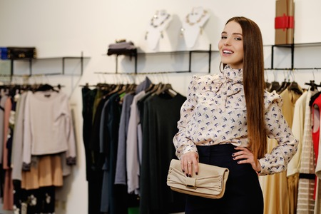 changing clothes: Fashionable young woman in a fashion showroom