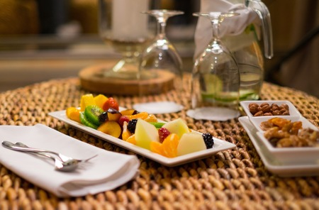 exotics: Plate with fresh fruits and refreshing drink on a table Stock Photo