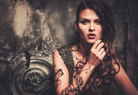 fantasy makeup: Tattooed beautiful woman in old spooky interior
