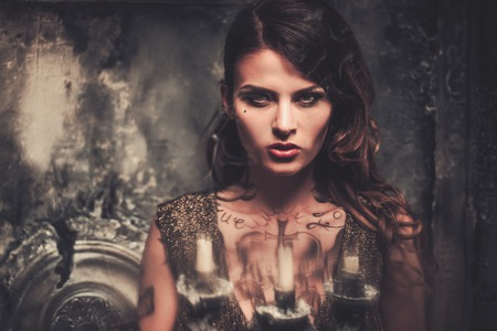 goth girl: Tattooed beautiful woman in old spooky interior