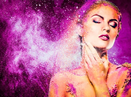 mind body spirit: Beautiful young woman with conceptual colourful body art