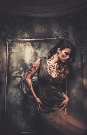 tattooed: Tattooed beautiful woman in old spooky interior