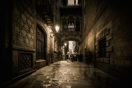old quarter: People walking at Carrer del Bisbe  in Barri Gotic, Barcelona