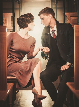 wood railroad: Vintage style couple inside retro train coach
