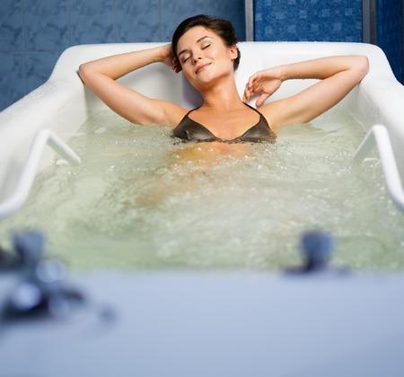 Woman having procedure in a  bathtub photo