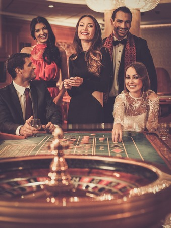 roulette player: Group of stylish people playing in a casino
